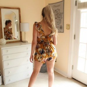 Lucca muted mango colored floral romper